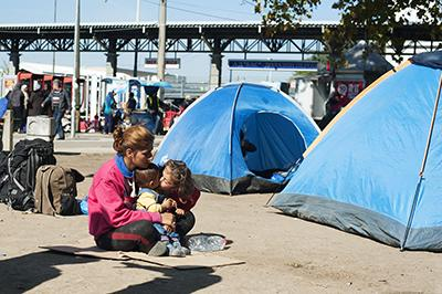 A moment of tenderness captured at park near a bus station in Belgrade. Photo by Kira Horvath for CRS