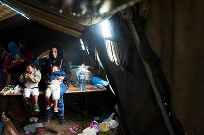 Families, although relieved to have made it to a safe continent, are physically spent. Few stop at refugee sites or transit camps for long. They rest for a few hours, maybe a day, determined to keep moving. Photo by Kira Horvath for CRS