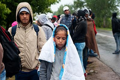 Refugees arrive in the Serbian border town of Kanjiza where they will wait at the Vasariste refugee aid point before continuing on to Hungary. Photo by Kira Horvath for CRS