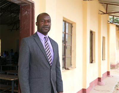 David Mwaitomupi, acting principal at Chidoma Secondary School, says even students who continue to attend may fall unconscious at school from hunger. Students may walk for several hours to school and back with empty stomachs. Photo by Nancy McNally/CRS