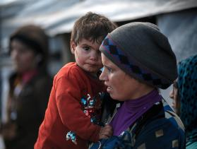 A mother and child who fled Syria at an informal camp in Lebanon.
