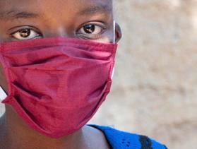 Cameroon woman wearing mask