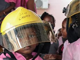 young girls in firefighter gear