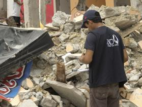 workers survey quake damage in Ecuador