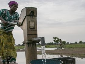 A woman in Jawani village utilizes a community borehole that was constructed with support from Catholic Relief Services in Ghana.