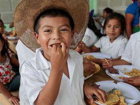 Little boy from Honduras eating food