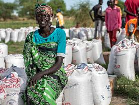 Woman posing at food distribution center in South Sudan