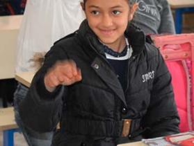 student in Iraq classroom