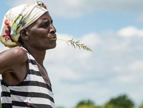 woman in field in Malawi